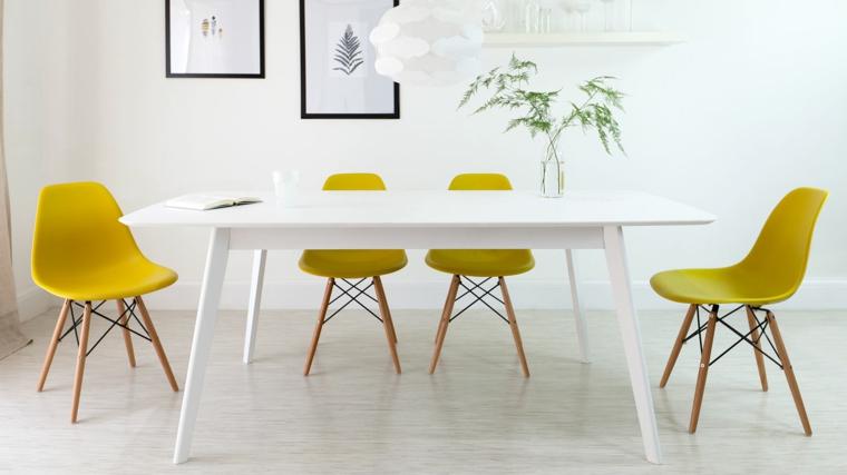 comedor blanco sillas Eames amarillas